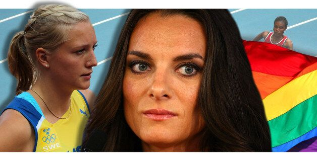 Russia's Yelena Isinbayeva smiles on the podium during the medal ceremony for the women's pole vault...