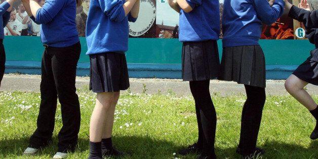 Undated file photos of children wearing their school