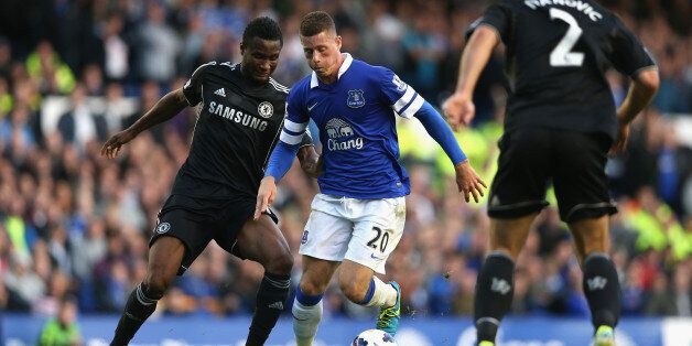 LIVERPOOL, ENGLAND - SEPTEMBER 14: Ross Barkley of Everton competes with John Obi Mikel of Chelsea during...
