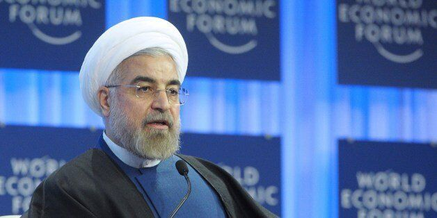 Iranian President Hassan Rouhani addresses the World Economic Forum in Davos on January 23, 2014. Some...