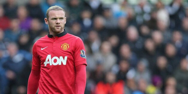 SWANSEA, WALES - AUGUST 17: Wayne Rooney of Manchester United in action during the Barclays Premier League...