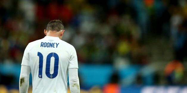 SAO PAULO, BRAZIL - JUNE 19: A dejected Wayne Rooney of England walks on after losing to Uruguay 2-1...