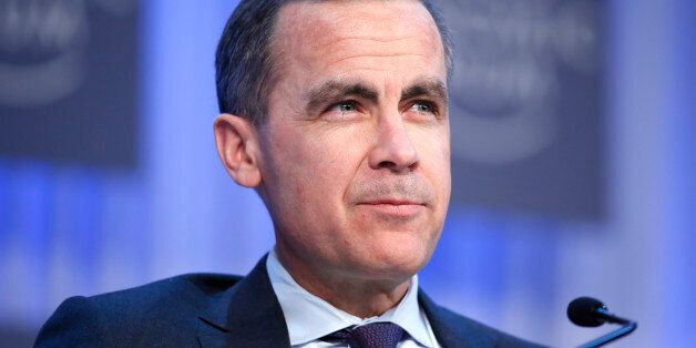 Mark J. Carney, governor of the central bank of Canada, listens during a session on the final day of...