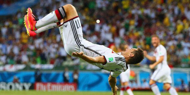 FORTALEZA, BRAZIL - JUNE 21: Miroslav Klose of Germany does a flip in celebration of scoring his team's...