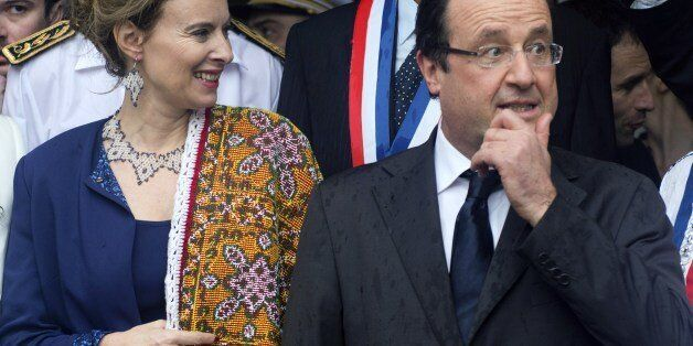 France's President Francois Hollande (R) and his companion Valerie Trierweiller attend an event in Mana,...