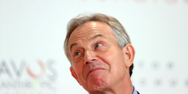 Tony Blair, former U.K. prime minister, reacts during a news conference on day two of the World Economic...