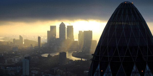 Embargoed to 0001 Monday January 20 File photo dated 25/02/10 of the 'Gherkin' and Canary Wharf at sunrise...