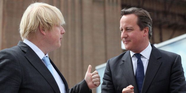 Prime Minister David Cameron chats to Boris Johnson (left), the Mayor of London, at Battersea Power Station...