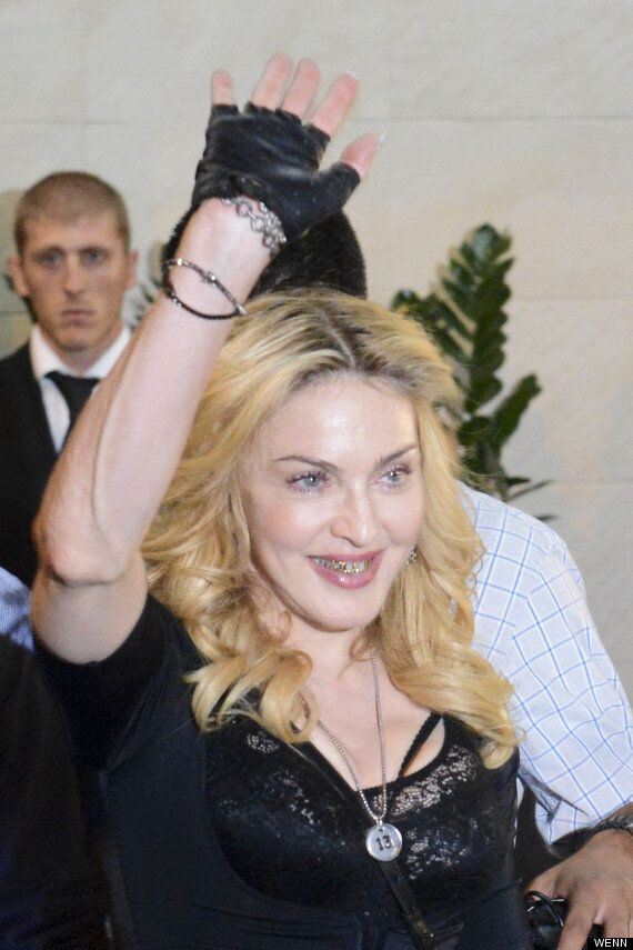 Madonna Flashes Fierce Grill As She Launches Fitness Centre In Rome (VIDEO,