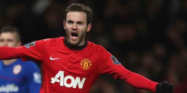 MANCHESTER, ENGLAND - JANUARY 28: Juan Mata of Manchester United celebrates Robin van Persie scoring...
