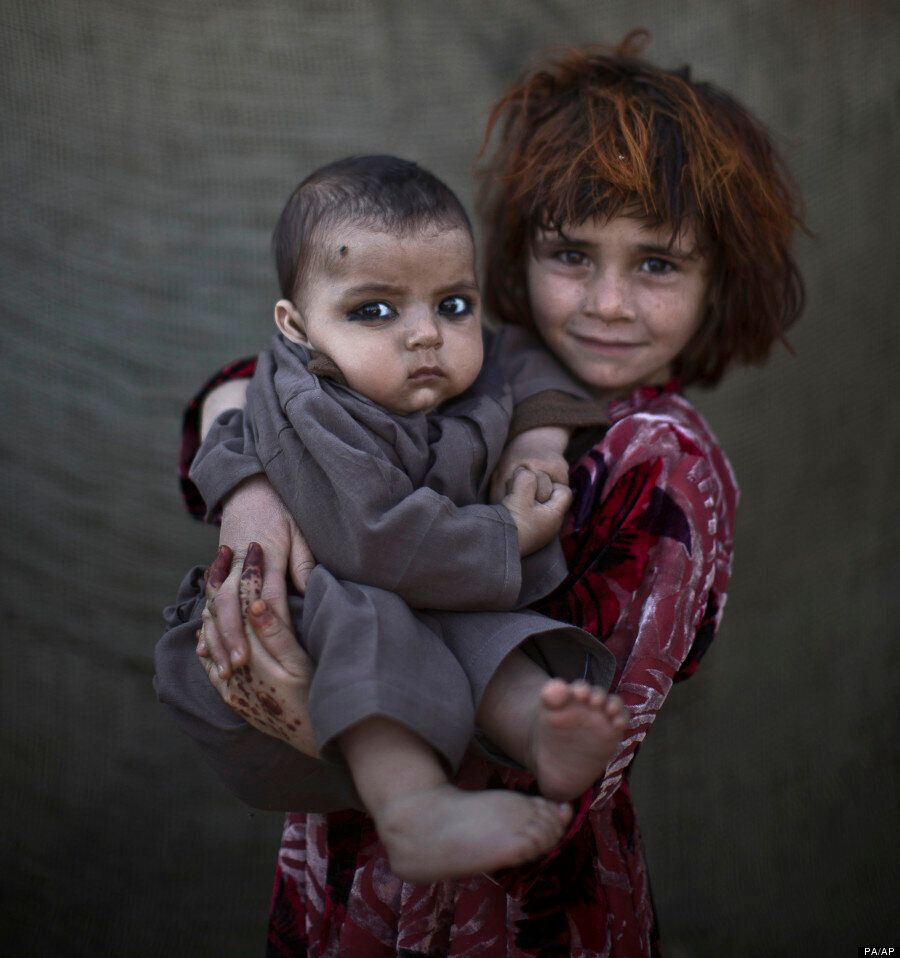 21 Haunting Portraits Of Afghanistan's Refugee Children Living In The Slums Of Islamabad