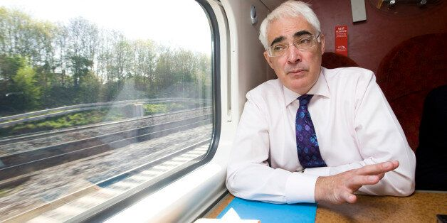 Alistair Darling, U.K. chancellor of the exchequer, speaks during an interview while travelling by train...