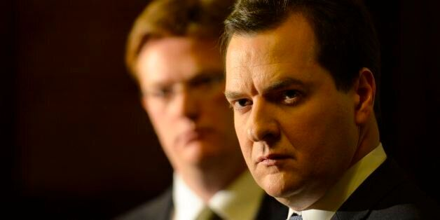 Chancellor of the Exchequer, George Osborne, watched by Chief Secretary to the Treasury Danny Alexander,...