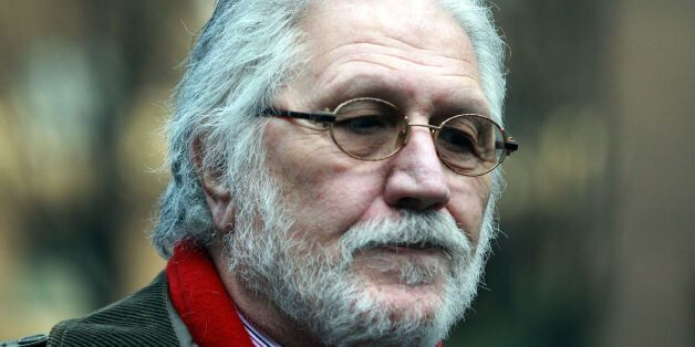 DJ Dave Lee Travis arrives at Southwark Crown Court in London where he is accused of a series of indecent...