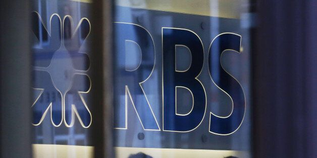 A sign is displayed inside the Royal Bank of Scotland Group Plc's (RBS) headquarters in London, U.K.,...