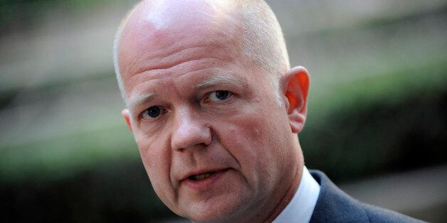 Britain's Foreign Secretary William Hague answers journalists' questions on July 22, 2013 before attending...