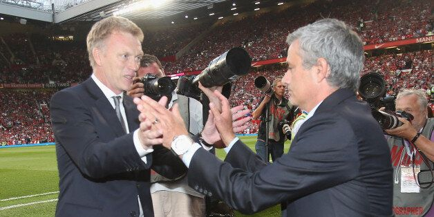 MANCHESTER, ENGLAND - AUGUST 26: Manager David Moyes of Manchester United greets manager Jose Mourinho...