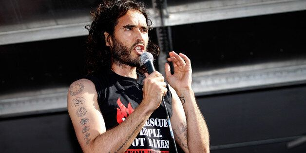 LONDON, ENGLAND - JUNE 21: Comedian Russell Brand speaks to a crowd of thousand of demonstrators that...