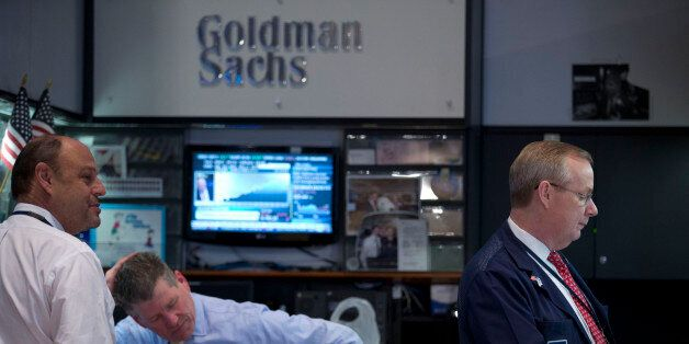 Traders work at the Goldman Sachs Group Inc. booth on the floor of the New York Stock Exchange (NYSE)...