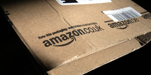 File photo dated 26/04/13 of the Amazon logo on a package. The online retail giant is to create 800 jobs...