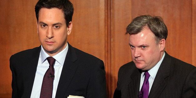 LONDON, ENGLAND - MARCH 14: Shadow Chancellor Ed Balls follows Labour Party Leader Ed Miliband from a...