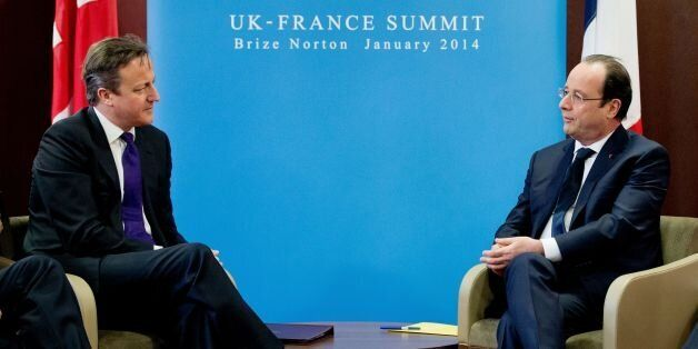 Prime Minister David Cameron (left) attends a meeting with French President Francois Hollande (right)...