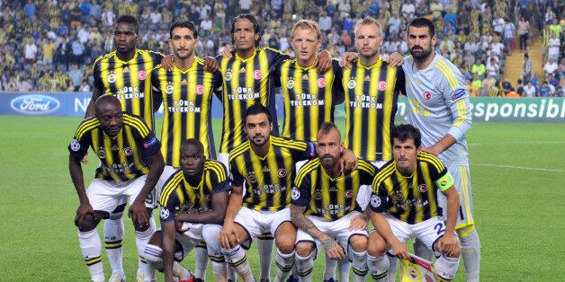 Fenerbahce's players pose during the UEFA Champions League Play Off first leg match between Fenerbahce...