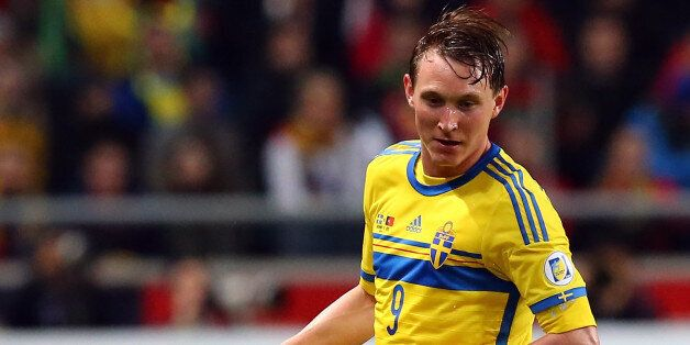 STOCKHOLM, SWEDEN - NOVEMBER 19: Kim Kaellstroem of Sweden runs with the ball during the FIFA 2014 World...
