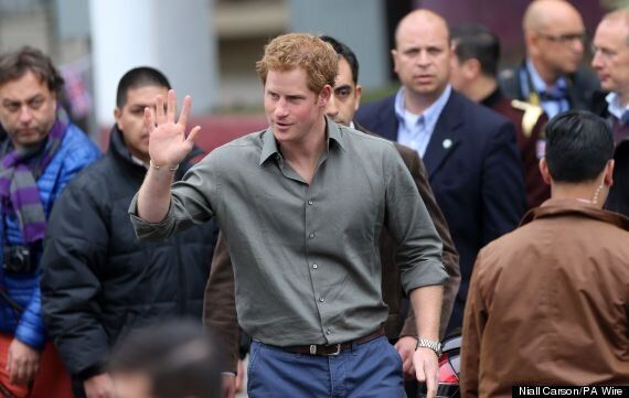 Prince Harry Begins Chile Visit By Helping Families Who Lost Homes In Devastating