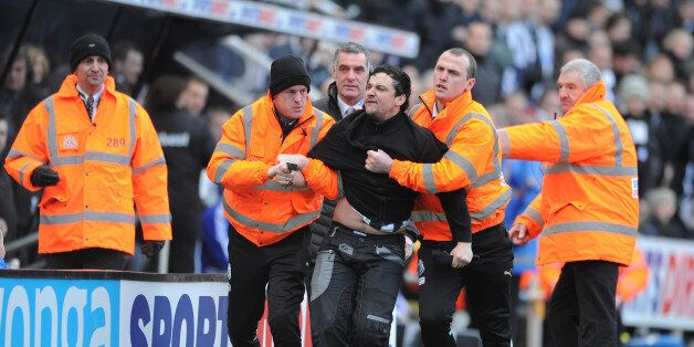 NEWCASTLE UPON TYNE, ENGLAND - FEBRUARY 01: A disgruntled Newcastle fan waving his season ticket is removed...