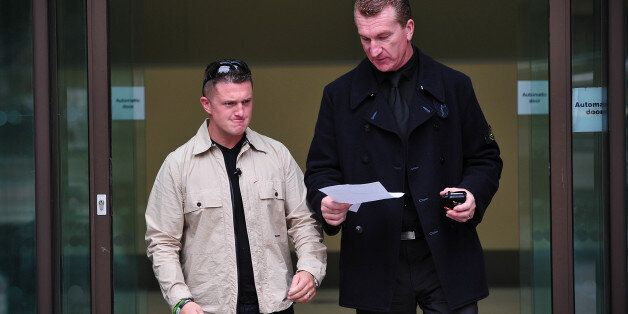 Stephen Yaxley-Lennon (L), also known as Tommy Robinson, the co-founder, spokesman and leader of the...