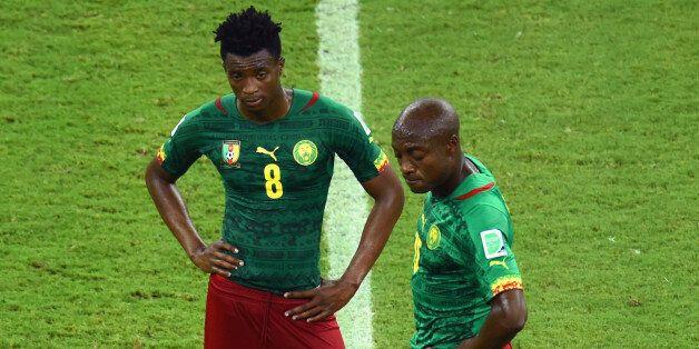 MANAUS, BRAZIL - JUNE 18: Benjamin Moukandjo and Pierre Webo of Cameroon wait to kick off after a goal...
