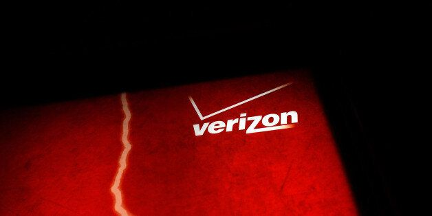 NEW YORK, NY - JUNE 07: A Verizon advertisement sits outside of a store on June 7, 2013 in New York City....