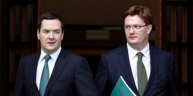 George Osborne, U.K. chancellor of the exchequer, left, and Danny Alexander, U.K. chief secretary to...