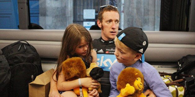Wiggins relaxes with his children after Stage Twenty of the Le Tour de France