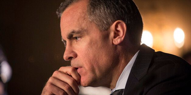 Mark Carney, governor of the Bank of England, pauses during a news conference in Edinburgh, U.K., on...