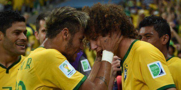 Brazil's forward Neymar (L) celebrates with Brazil's defender David Luiz during the quarter-final football...