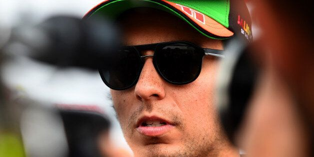 NORTHAMPTON, ENGLAND - JULY 03: Sergio Perez of Mexico and Force India speaks to members of the media...