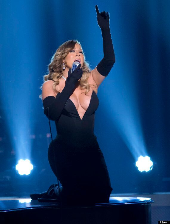 Mariah Carey Dazzles In Gravity-Defying, Cleavage-Busting Dress As She Performs At BET Honors Bash