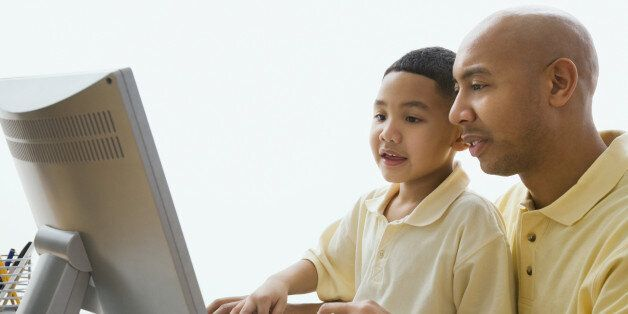 Stock image of man helping young boy