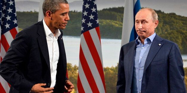 US President Barack Obama (L) holds a bilateral meeting with Russian President Vladimir Putin during...