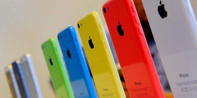 The new Apple Inc. iPhone 5C sit on display during a product announcement in Cupertino, California, U.S.,...