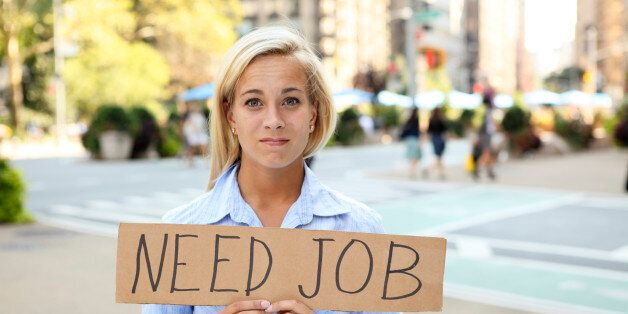 A woman holding a sign saying 'need