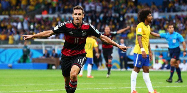 BELO HORIZONTE, BRAZIL - JULY 08: Miroslav Klose of Germany celebrates scoring his team's second goal...