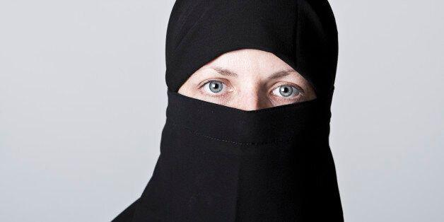 Woman wearing niqab and hijab,