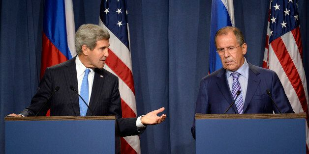 US Secretary of State John Kerry (L) and Russian Foreign minister Sergey Lavrov (R) give a press conference...