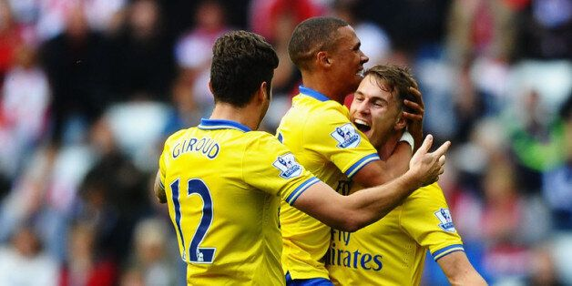 SUNDERLAND, ENGLAND - SEPTEMBER 14: Aaron Ramsey (R) of Arsenal celebrates his goal with team mates Kieran...