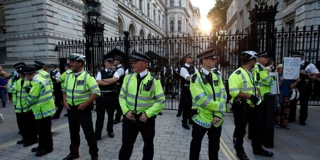 Police stand guard outside Downing