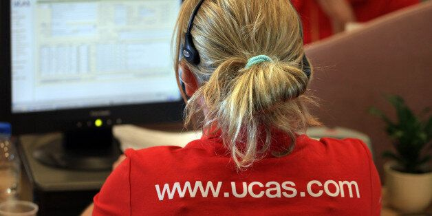 CHELTENHAM, ENGLAND - AUGUST 19: An employee in the Ucas clearing house call centre answers enquiries...