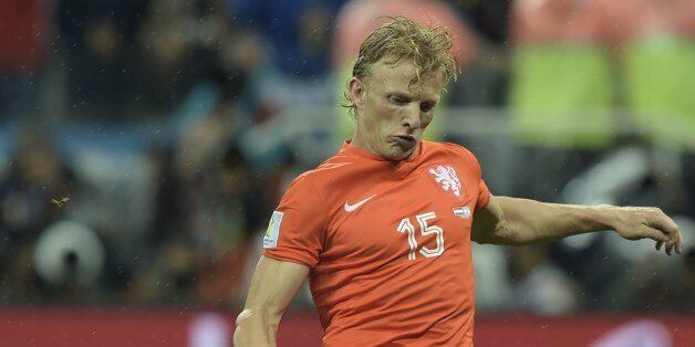 Netherlands' midfielder Dirk Kuyt takes a shot during penalty shoot-outs following extra time during...